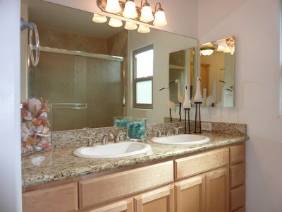 Double sinks and granite counter vanity.