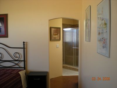 Large bedroom leads to a very large bath with w/d and walk in closet, w/skylight