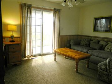 French doors to private Den, combo DVD/VCR TV in armoire, desk, slider to deck.