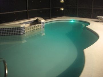 Nighttime Swimming Pool with LED lighting