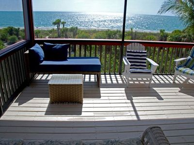 Covered screened porch by the sea for lounging and relaxing.