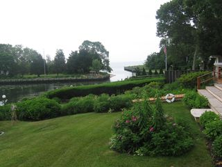 Laurel house photo - Rear lawn view of Great Peconic Bay. Bird bath and purple martin nesting area