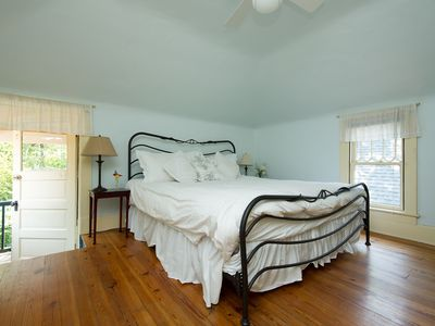The rear bedroom with king size bed and private balcony