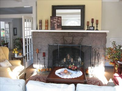 Living room featuring original granite fireplace and paladium window