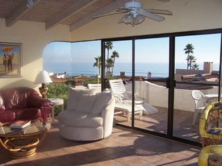 Las Gaviotas house photo - Living room & deck with exceptional views