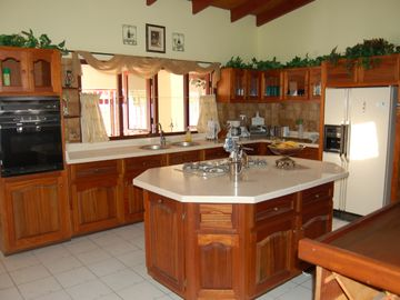 Kitchen, island, fridge, stove, oven, etc