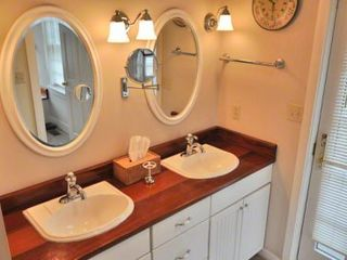 Katama house photo - Master Bath Features Yacht-Style Mahogany Double Vanity & Private Door To Outdoor Shower