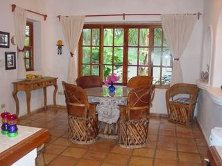 Dining table seats up to 7; more space at counter. - Playa del Carmen villa vacation rental photo