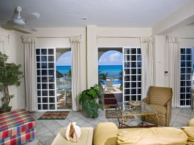 Panoramic ocean views from main living room, kitchen, and dining room.