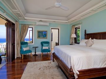 Enjoy delightful views of the blue Caribbean from your bedroom