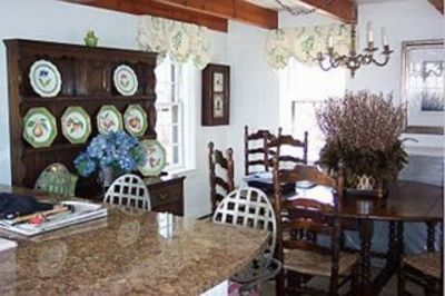 Dining area with antique table/chairs and light fixture