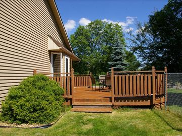 Large deck complete with seating and outdoor grill