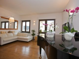 Matelica house photo - Living room with baby grand piano