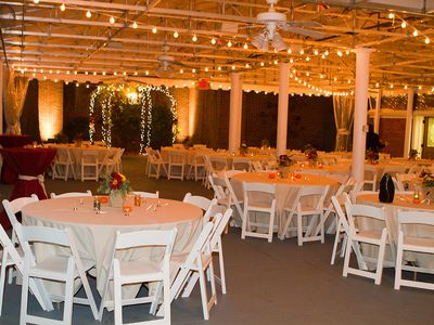Canopied courtyard reception set up with gazebo for wedding ceremonies