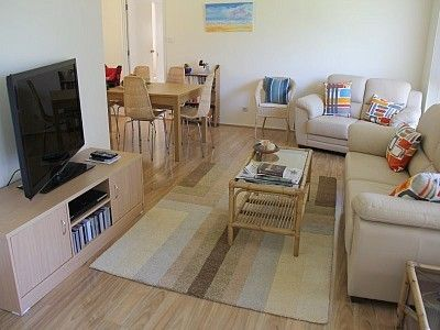 Port Macquarie house rental - Tastefully decorated lounge room with TV