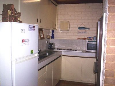 Fully equipped kitchen/Laundry