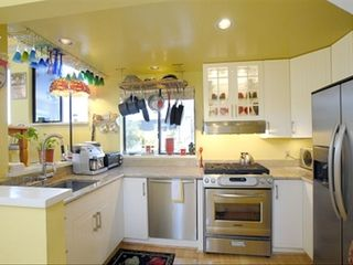 Sausalito house boat photo - Kitchen with kitchen aid stove, dishwasher, full size refigerator