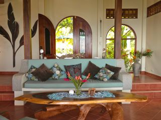 Uvita villa photo - Living room. With views of infinity pool and ocean.