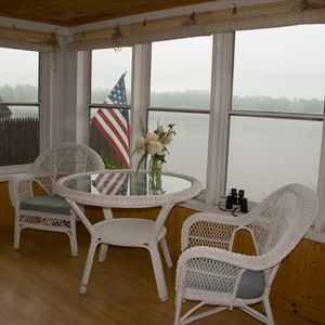 The enclosed porch has wonderful lake & mountain views!