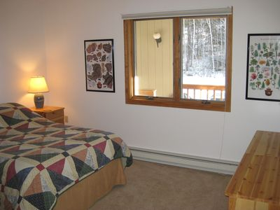 Bedroom with double bed and view of birch trees