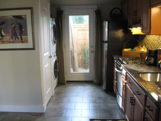 Georgetown apartment photo - Looking at the Kitchen, Washer/Dryer, Pantry and back door.