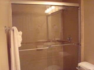 Ocean Reef condo photo - Beautifully remodeled master bathroom now features tile/glass shower.