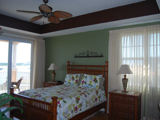 Clearwater Beach condo photo - Master Bedroom To Balcony /Great Views from Balcony/Wood Floors/T.V/ Clock-Radio