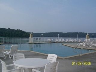 Osage Beach condo photo - Outdoor pool with waterfall and park and lake view