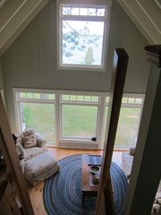 A view to the first floor from the loft. - Harpswell cottage vacation rental photo