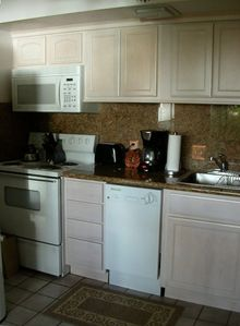 our remodeled kitchen with granite countertops
