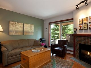Whistler townhome photo - Living Room w Fireplace - Looking onto Patio w/Private Hot Tub