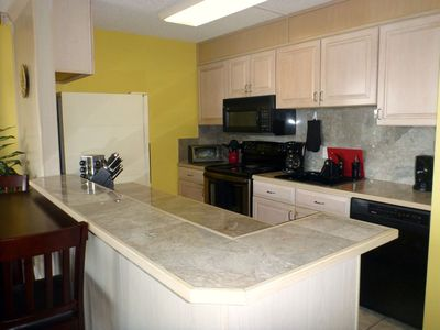 Kitchen, fully stocked, marble countertops