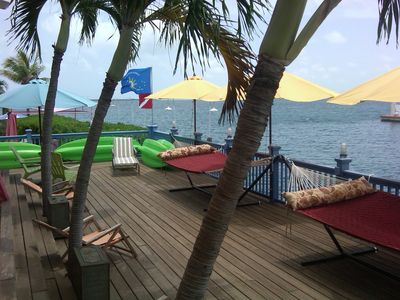 lower porch with hammocks palms tree coming thru porch  kayaks   palm boards