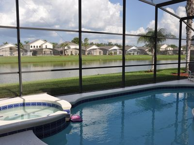 Enjoy lake views while relaxing in the pool and spa