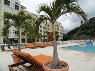 Aguadilla condo photo - Enjoy the infinity swimming pool with whirl pool and kiddie pool