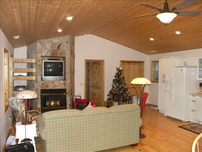Kitchen & Great Room Seating in Front of TV & Remote Control Gas Fireplace.