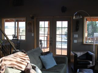 Miles City cabin photo - living room area includes large flat screen and 7 channel surround sound