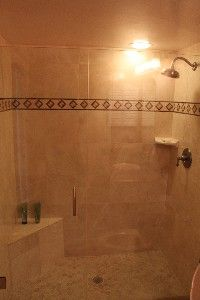 Master bath includes glass shower stall w/tile and a new jetted Jacuzzi tub.
