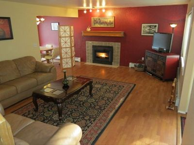 Anchorage house rental - Large open living room with flat screen T.V., DVD Library, gas fireplace