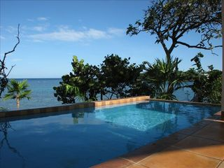 The view across the bay and pool from the front veranda. - Roatan villa vacation rental photo