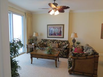Ocean Villa Resort condo rental - Watch the dolphins while sitting in the living room.