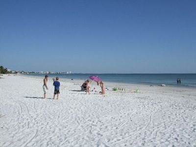 7 Miles of white sugar-sand beach waiting for you just a 1 minute walk away