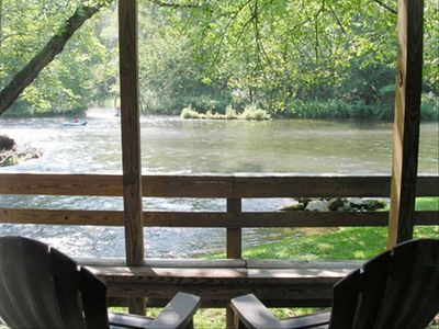 Relax on the covered deck and enjoy the rushing sounds of the river