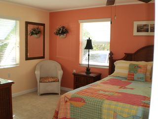 Little Torch Key house photo - King bedroom suite #2, painted in bright tropical colors.
