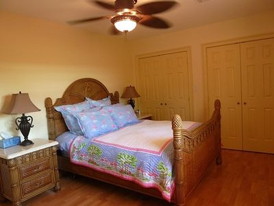 Third bedroom is large and professionally furnished with hardwood floors.