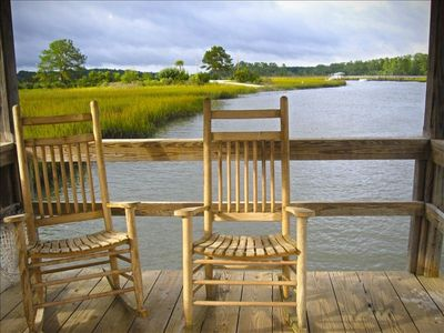 Take in the Scenery while Relaxing in Rocking Chairs on the Dock