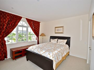 Guest bedroom on 3rd Floor with walk in closet and refrigerator