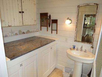 Laundry room houses the washer/dryer and doubles as a half bath.