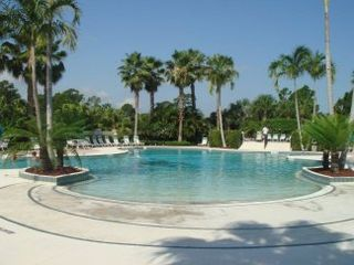 Port St. Lucie condo photo - Zero Entry Heated pool, Beautifully Landscaped, with Sun Deck and Hot Tub/Spa