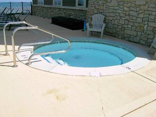 Traverse City condo photo - Hot tub available during the summer months.